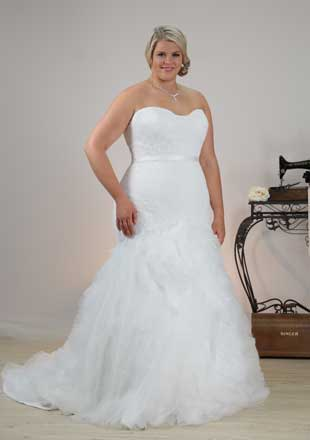 Mermaid plus size wedding dress featuring unique full skirt and lace bodice