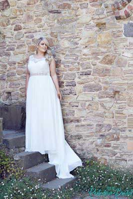 Lee Plus size wedding dresses with sleeves with the ultimate bridal belt.