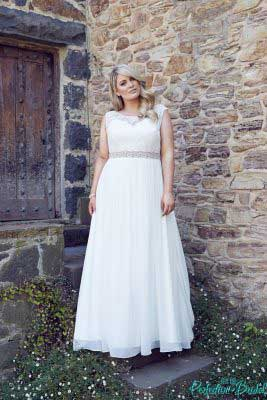 Plus size wedding dress with sleeves pictured with the ultimate bridal belt.