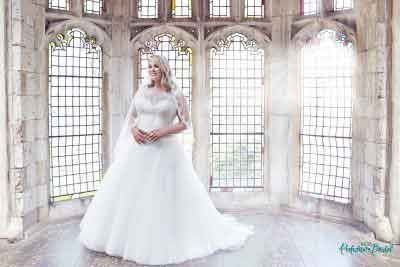 Anastasia wedding dress with matching lace trim cathedral veil.