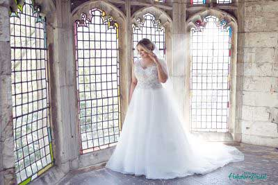 Beaded wedding dresses Gwyneth gown in church