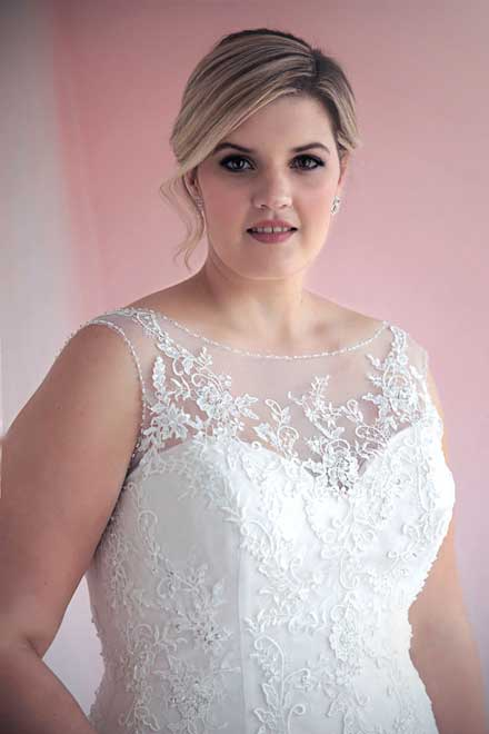 Genevieve fit and flare wedding dress with illusion neckline.